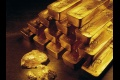Cena zlata vzrástla a smeruje k 1700 USD za uncu