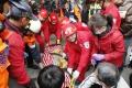 Taiwan: Záchranári zaregistrovali pod troskami budovy prejavy života